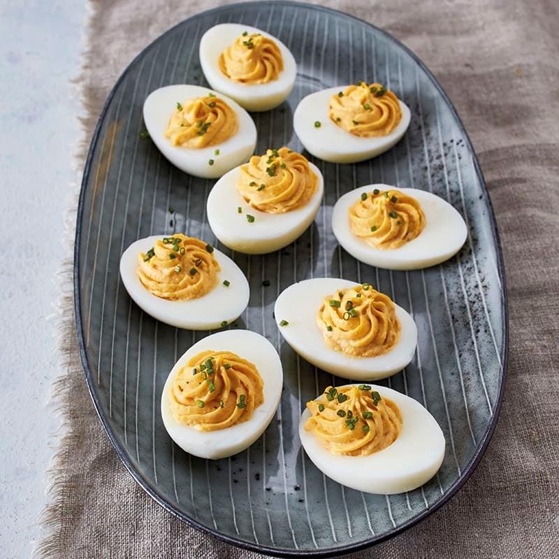 Foto van Gevulde eieren met bieslookringetjes door WW